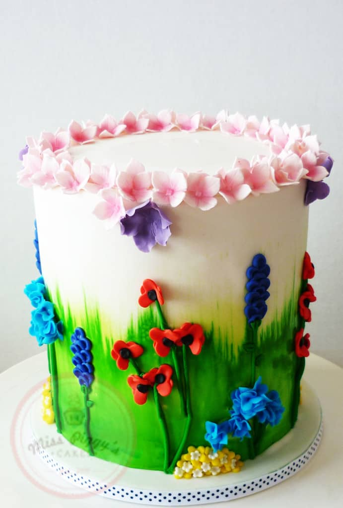 Learn how to make a beautiful floral 90th birthday cake for your favorite lady!